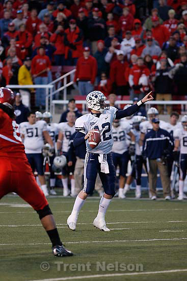 BYU quarterback John Beck in the pocket on the last play of the game, looking for a receiver, then making the throw (SEQUENCE OF FOUR). BYU wins with no time on the clock. Salt Lake City - Utah vs. BYU college football at Rice-Eccles Stadium.<br />
