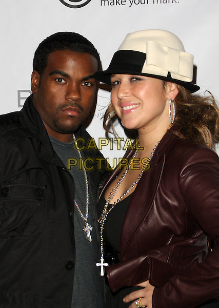 RODNEY JERKINS & JOY ENRIQUE-JERKINS .MusicMogul.com Launch Party held at The Thompson Hotel, Beverly Hills, California, USA, 24th November 2008..half length hat silver cross necklaces matching crosses necklace .CAP/ADM/KB.©Kevan Brooks/Admedia/Capital PIctures