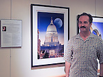 "Photographer Michael Knapstein with his ""Selected Works"" exhibition at Capitol Lakes in Madison, Wisconsin"