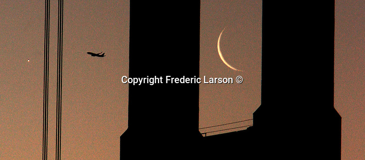 Seen from the Marin headlands over the south tower of the Golden Gate Bridge was both the crescent moon and the planet Venus that rose together within minutes of each other during the morning twilight.