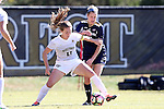 23 October 2016: Wake Forest's Maddie Huster (11) and Notre Dame's Kaleigh Olmsted (behind). The Wake Forest University Demon Deacons hosted the University of Notre Dame Fighting Irish at Spry Stadium in Winston-Salem, North Carolina in a 2016 NCAA Division I Women's Soccer match. Notre Dame won the game 1-0.