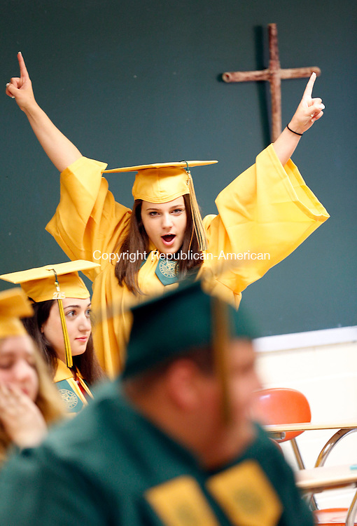 Waterbury, CT- 31 May 2015-053115CM01- Holy Cross High School graduate, Alexis Malaspina shows her excitement before the start of commencement exercises at Holy Cross High School in Waterbury on Sunday.  Christopher Massa Republican-American