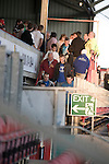 Bangor City 0 FC Honka 1, 23/07/2009. Racecourse Ground, Europa League. Bangor City supporters filing out of the main stand at Wrexham's Racecourse Ground at half-time, the venue for their sides Europa League second round second leg tie against FC Honka from Finland. The match had to be staged away from City's Farrar Road ground as it did not meet UEFA's stadium standards. The Finns won 1-0 in Wales to go through 3-0 on aggregate in front of 602 spectators in the first season of the newly-introduced competition which replaced the UEFA Cup. Photo by Colin McPherson.