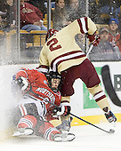 Drew Ellement (Northeastern - 2), Brian Dumoulin (BC - 2) - The Boston College Eagles defeated the Northeastern University Huskies 7-1 in the opening round of the 2012 Beanpot on Monday, February 6, 2012, at TD Garden in Boston, Massachusetts.