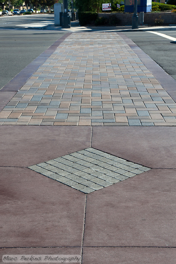 """The colored-concrete (and stone?) crosswalk at the Grand and Diamond Bar intersection. This was part of the 2015 rebuild of the Grand Avenue and Diamond Bar Boulevard intersection for Diamond Bar's 2015 """"Grand Avenue Beautification"""" project, landscape architecture for the project was by David Volz Design."""