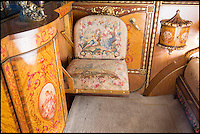 BNPS.co.uk (01202 558833)<br /> Pic: Bonhams/BNPS<br /> <br /> Tapestry covered seats and satinwood cabinets.<br /> <br /> Palace on wheels - unique Rolls Royce with an interior inspired by Marie Antoinette.<br /> <br /> Possibly the worlds most luxurious Rolls Royce with an amazing interior that wouldn't look out of place at the Palace of Versailles has emerged at auction. <br /> <br /> American Woolworths heir C.W. Gasque ordered the car for his wife in 1926, and was inspired to modify the cabin of the Phantom I after seeing a sedan chair that had belonged to Marie Antoinette displayed at the V&amp;A museum.<br /> <br /> The stunning bespoke interior features satinwood marquetry cabinets, a painted ceiling with cupids and cherubs, and embroided seats made from historic tapestries.<br /> <br /> Your aristocratic progress is further enhanced by a crystal decanter, silver service, confectionary bowl, french flower vases and silk curtains.<br /> <br /> However you may need a Sun King's ransom to buy the magnificent machine when its sold by Bonhams on December 4th with an estimate of &pound;700,000.