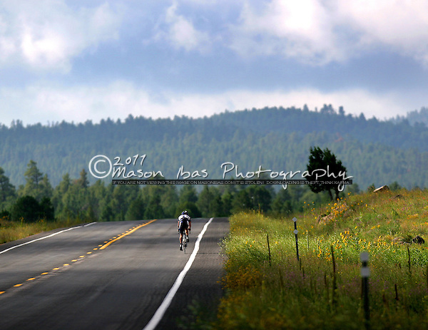 A lone rider breaks away during the Arizona Road Race Championships at Mormon Lake Arizona. The area, just south of Flagstaff, is nestled within the Coconino National Forest.
