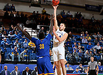 SIOUX FALLS, SD - NOVEMBER 28: Mike Daum #24 from South Dakota State University shoots over Aleer Leek #30 from UMKC during their game Wednesday night at Frost Arena in Brookings, SD. (Photo by Dave Eggen/Inertia)