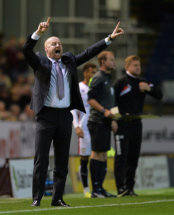 Burnley's Manager Sean Dyche shouts instructions to his team from the dug-out<br /> <br /> Photographer Dave Howarth/CameraSport<br /> <br /> Football - The Football League Sky Bet Championship - Burnley v Milton Keynes Dons - Tuesday 15th September 2015 - Turf Moor - Burnley<br /> <br /> &copy; CameraSport - 43 Linden Ave. Countesthorpe. Leicester. England. LE8 5PG - Tel: +44 (0) 116 277 4147 - admin@camerasport.com - www.camerasport.com