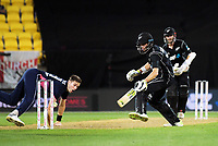 England bowler Chris Woakes runs out Mitchell Santner during the One Day International cricket match between the New Zealand Black Caps and England at the Westpac Stadium in Wellington, New Zealand on Friday, 2 March 2018. Photo: Dave Lintott / lintottphoto.co.nz
