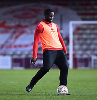 Lincoln City's John Akinde warms up at half time<br /> <br /> Photographer Andrew Vaughan/CameraSport<br /> <br /> The Emirates FA Cup Second Round - Lincoln City v Carlisle United - Saturday 1st December 2018 - Sincil Bank - Lincoln<br />  <br /> World Copyright © 2018 CameraSport. All rights reserved. 43 Linden Ave. Countesthorpe. Leicester. England. LE8 5PG - Tel: +44 (0) 116 277 4147 - admin@camerasport.com - www.camerasport.com