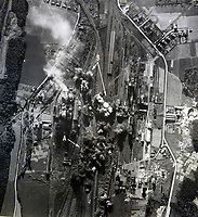 BNPS.co.uk (01202 558833)<br /> Pic:  Tooveys/BNPS<br /> <br /> Taken 21/09/41 - Bombing raid on the electric power station and chemical works at Gosnay, near Béthune, France.<br /> <br /> Dramatic photos showing a series of heart-pounding World War Two bombing raids from the pilot's perspective have come to light.<br /> <br /> They were taken from Blenheim bombers undertaking attacks on targets in Germany and Nazi-occupied Netherlands in 1941.<br /> <br /> Several capture the immediate aftermath of a direct hit, with flames and clouds of smoke signifying they had achieved their aim.<br /> <br /> The album, which contains almost 100 photos, has emerged for sale with Toovey's Auctions, of Washington, west Sussex.