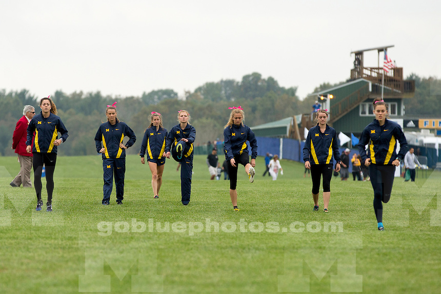 Michigan women's cross country team members warm up before the Indiana State Pre-National Cross Country Invitational on Saturday, Oct. 15, 2016, in Terre Haute, Indiana. (Photo by James Brosher)