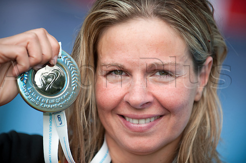 Germany's AngelaMaurer smiles with her silver medal after the 25km Open Water competition in Balatonfured, Hungary, 08 August 2010. Maurer finished second and won the silver medal in a split-second decision at the 30th LEN European Championships.