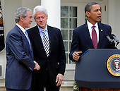 U.S. President Barack Obama (R) makes remarks as former Presidents Bill Clinton (C) and George W. Bush shake hands after their meeting in the Oval Office, in the  aftermath of the devastating earthquake in Haiti, at the White House in Washington, DC, USA,  16 January 2010.  Obama discussed enlisting the help of the American people to help in the recovery and rebuilding of Haiti. .Credit: Mike Theiler / Pool via CNP