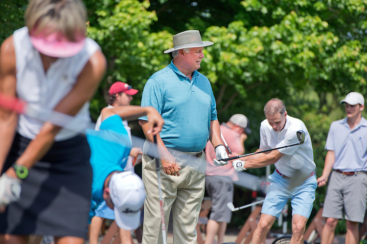UNITED STATES - MAY 18: Rep. Albio Sires, D-N.J., warms up before participating in the 2015 Politics & Pros Golf Classic charity event held at Bethesda Country Club, May 18, 2015. (Photo By Tom Williams/CQ Roll Call)
