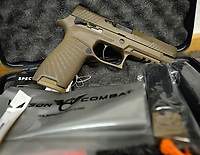 Wilson Combat in Berryville is working with gun maker Sig Sauer to provide custom work on two of the company's most popular handguns. This M-17, seen Wednesday, March 4, 2020, features the Wilson Combat starburst stipple pattern as well as improved machine work and Wilson Combat logo. Visit nwaonline.com/200308Daily/ for today's photo gallery.<br /> (NWA Democrat-Gazette/Andy Shupe)