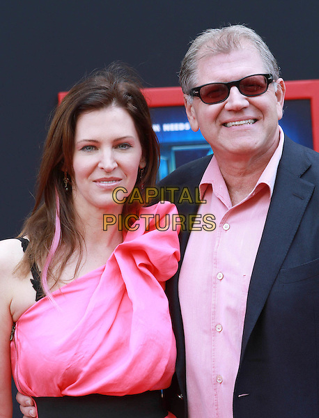 "LESLIE ZEMECKIS & ROBERT ZEMECKIS .""Mars Needs Moms 3D"" Los Angeles Premiere Held At The EL Capitan Theatre, Hollywood, California, USA..March 6th, 2011.half length black pink shirt one shoulder dress sunglasses shades married husband wife .CAP/ADM/KB.©Kevan Brooks/AdMedia/Capital Pictures."