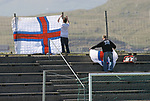 Faroe Islands 0 Scotland 2, 06/06/2007. Svangaskard, Toftir, Euro 2008 Qualifying. Two Faroese fans putting up flags behind the goals before the Euro 2008 group B qualifying match at the Svangaskard stadium in Toftir between the Faroe Islands and Scotland. The visitors won the match by 2 goals to nil to stay in contention for a place at the European football championships which were to be held in Switzerland and Austria in the Summer of 2008. It was the first time Scotland had won in the Faroes, the previous two matches ended in draws. Photo by Colin McPherson.