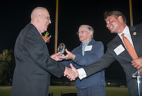 Bob Ashford '52 accepts the Athletics Hall of Fame award from Murray Via '54 and Master of Ceremonies Paul Finchamp '80. Alumni, family, staff and students at the Occidental College Athletics Hall of Fame event, part of Homecoming weekend, Oct. 24, 2014 on Patterson Field. (Photo by Marc Campos, Occidental College Photographer)