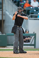 Home plate umpire Shane Livensparger makes a strike call during the International League game between the Lehigh Valley IronPigs and the Charlotte Knights at BB&T BallPark on May 30, 2015 in Charlotte, North Carolina.  The IronPigs defeated the Knights 1-0.  (Brian Westerholt/Four Seam Images)