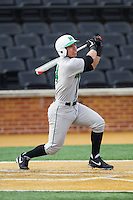 Andrew Dundon (14) of the Marshall Thundering Herd follows through on his swing against the Wake Forest Demon Deacons at Wake Forest Baseball Park on February 17, 2014 in Winston-Salem, North Carolina.  The Demon Deacons defeated the Thundering Herd 4-3.  (Brian Westerholt/Four Seam Images)