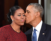 United States President Barack Obama (R) gives Michelle Obama a kiss as they wait for President-elect Donald Trump and wife Melania at the White House before the inauguration on January 20, 2017 in Washington, D.C.  Trump becomes the 45th President of the United States.      Photo by Kevin Dietsch/UPI<br /> Credit: Kevin Dietsch / Pool via CNP