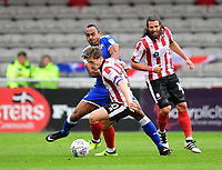 Lincoln City's Alex Woodyard vies for possession with Chesterfield's Chris O'Grady<br /> <br /> Photographer Chris Vaughan/CameraSport<br /> <br /> The EFL Sky Bet League Two - Lincoln City v Chesterfield - Saturday 7th October 2017 - Sincil Bank - Lincoln<br /> <br /> World Copyright &copy; 2017 CameraSport. All rights reserved. 43 Linden Ave. Countesthorpe. Leicester. England. LE8 5PG - Tel: +44 (0) 116 277 4147 - admin@camerasport.com - www.camerasport.com