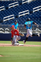 Washington Nationals first baseman Drew Mendoza (13) stretches for a throw as Osiris Johnson (56) runs through the bag during an Instructional League game against the Miami Marlins on September 26, 2019 at FITTEAM Ballpark of The Palm Beaches in Palm Beach, Florida.  (Mike Janes/Four Seam Images)