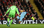 Raheem Sterling of Manchester City has a shot at Simon Mignolet of Liverpool during the English Premier League match at Anfield Stadium, Liverpool. Picture date: December 31st, 2016. Photo credit should read: Lynne Cameron/Sportimage