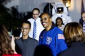 Student Ahmed Mohamed (L) of Irving, Texas poses with astronaut Colonel Benjamin Alvin Drew (R) during the second  White House Astronomy Night attended by students, teachers, scientists, astronauts and others  in the South Lawn of the White House in Washington, DC on October 19, 2015. Mohamed was arrested for bringing a homemade clock to school earlier this month. <br /> Credit: Aude Guerrucci / Pool via CNP