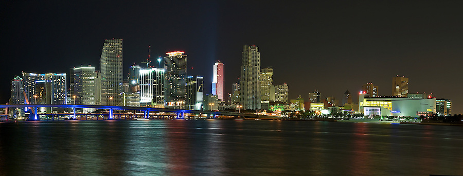 Panoramic view of downton Miami at night, with space for copy in the water.