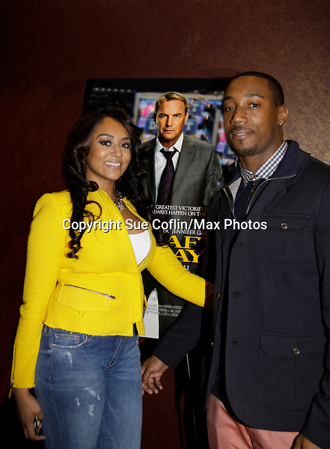 """Tiffany poses with her husband New York Giants Mario Manningham who is the host at the Private VIP Screening of """"Draft Day"""" on April 3, 2014 at the AMC Loews, New York City, New York. (Photo by Sue Coflin/Max Photos)"""