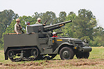 Reenactors showcase World War II tanks, half-tracks and support vehicles during the Museum of the America G.I.'s annual Open House on March 29, 2008 in College Station, Texas. An USMC M3 Halftrack with 75mm Gun appears before the crowd.