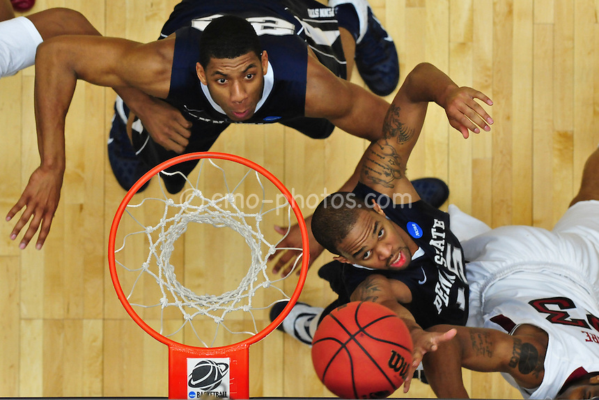 Mar 17, 2011; Tucson, AZ, USA; Penn State Nittany Lions forward David Jackson (15) tries to block the shot of Temple Owls guard Ramone Moore (23) in the second half of a game in the second round of the 2011 NCAA men's basketball tournament at the McKale Center. The Aztecs won 68-50.