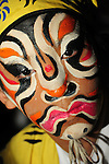 Ghost Month, Kaohsiung - Performer of the Rom Shing Hakka Opera Troupe with finished make-up before an open-air stage performance during Ghost Month in front of the Bao-Jhong Yi-Min Temple in Kaohsiung, Taiwan.