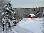 View of a road and barn after a snowstowm. Dresden, Lincoln County, Maine, USA