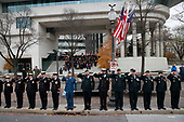 Canadian military salute on the sidewalk outside the Canadian Embassy, as the hearse carrying the flag-draped casket of former President George H.W. Bush drive by on Pennsylvania Ave. from the Capitol to a State Funeral at the National Cathedral, Wednesday, Dec. 5, 2018, in Washington. <br /> Credit: Alex Brandon / Pool via CNP
