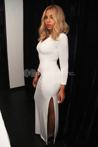 BEVERLY HILLS, CA - JUNE 28, 2014<br /> Ashanti attends the Young Money Official BET Awards Pre Party at Philippe Chow June 28, 2014 in Beverly Hills, CA<br /> &copy; Walik Goshorn / MediaPunch