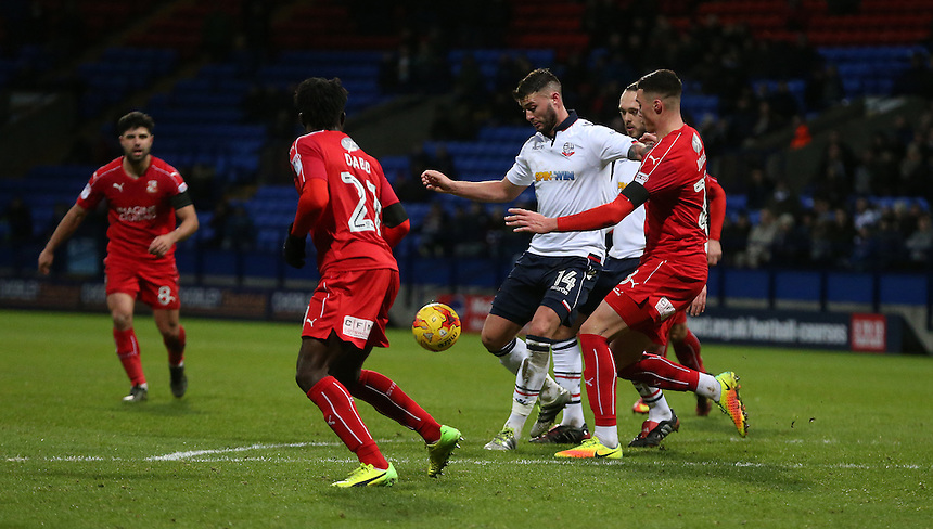 Bolton Wanderers' Gary Madine fights to get himself a shooting opportunity<br /> <br /> Photographer Stephen White/CameraSport<br /> <br /> The EFL Sky Bet League One - Bolton Wanderers v Swindon Town - Saturday 14th January 2017 - Macron Stadium - Bolton<br /> <br /> World Copyright &copy; 2017 CameraSport. All rights reserved. 43 Linden Ave. Countesthorpe. Leicester. England. LE8 5PG - Tel: +44 (0) 116 277 4147 - admin@camerasport.com - www.camerasport.com