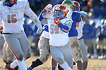 Bishop Gorman's Alfredo Bernall III (59) battles against Reed in an NIAA Division I playoff game at Reed High School in Sparks, Nev., on Saturday, Nov. 28, 2015. Bishop Gorman won 41-13. (Cathleen Allison/Las Vegas Review-Journal)