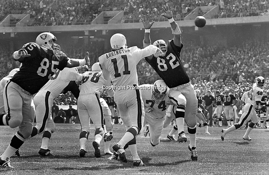 Raiders Carleton Oats and Horace Jones put the rush on Phadelphia Eagles QB Rick Arrington. (1971 photo/Ron Riesterer)