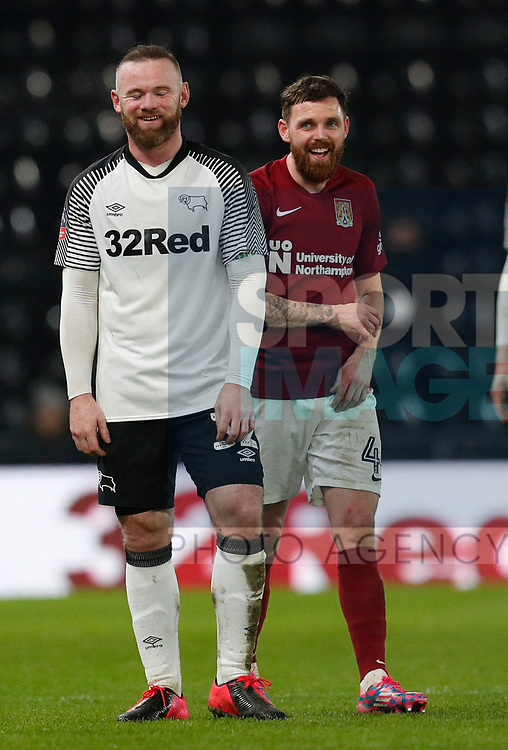Wayne Rooney of Derby County shares a joke with Paul Anderson of Northampton during the FA Cup match at the Pride Park Stadium, Derby. Picture date: 4th February 2020. Picture credit should read: Darren Staples/Sportimage
