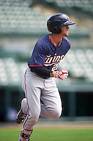 GCL Twins second baseman Dane Hutcheon (21) runs to first during a game against the GCL Orioles on August 11, 2016 at the Ed Smith Stadium in Sarasota, Florida.  GCL Twins defeated GCL Orioles 4-3.  (Mike Janes/Four Seam Images)
