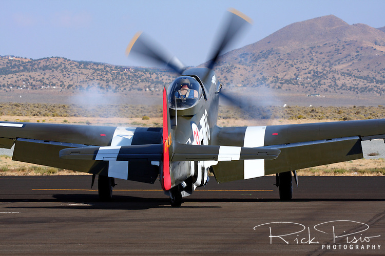The Rolls Royce Merlin engine of the P-51 Mustang air racer Speedball Alice starts prior to a heat race at the Reno Reno National Championship Air Races