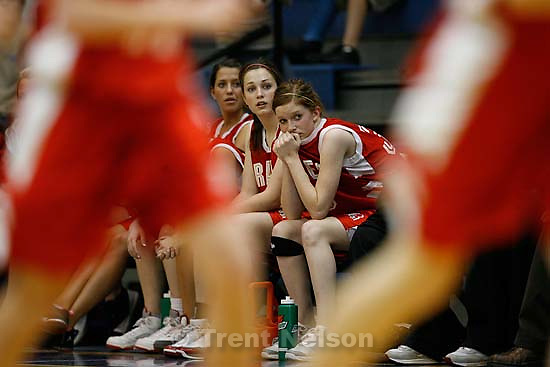 On the bench as time runs out on Bountiful's season are, left to right, Kortney Murdock, Brittney Kelly, and Ashlyn Hewlett. Taylorsville - Orem vs. Bountiful High School, 4A Girls State Basketball Championships at Salt Lake Community College.