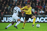 Kyle Naughton of Swansea City battles with Connor Mahoney of Millwall during the Sky Bet Championship match between Swansea City and Millwall at the Liberty Stadium in Swansea, Wales, UK. Saturday 23rd November 2019