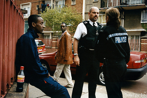 Police officers arrest a Somalian youth suspected of robbery in Leicester city, UK.....In the 1990s ten of thousands of Netherlands-based Somalians migrated en masse to the UK for better opportunities, many of them settling in Leicester. ....Leicester is expected to be the first city in the UK to have a majority non-white population within the next few years. It is one of the most ethnically-diverse cities in Europe. ....Picture taken April 2005 by Justin Jin