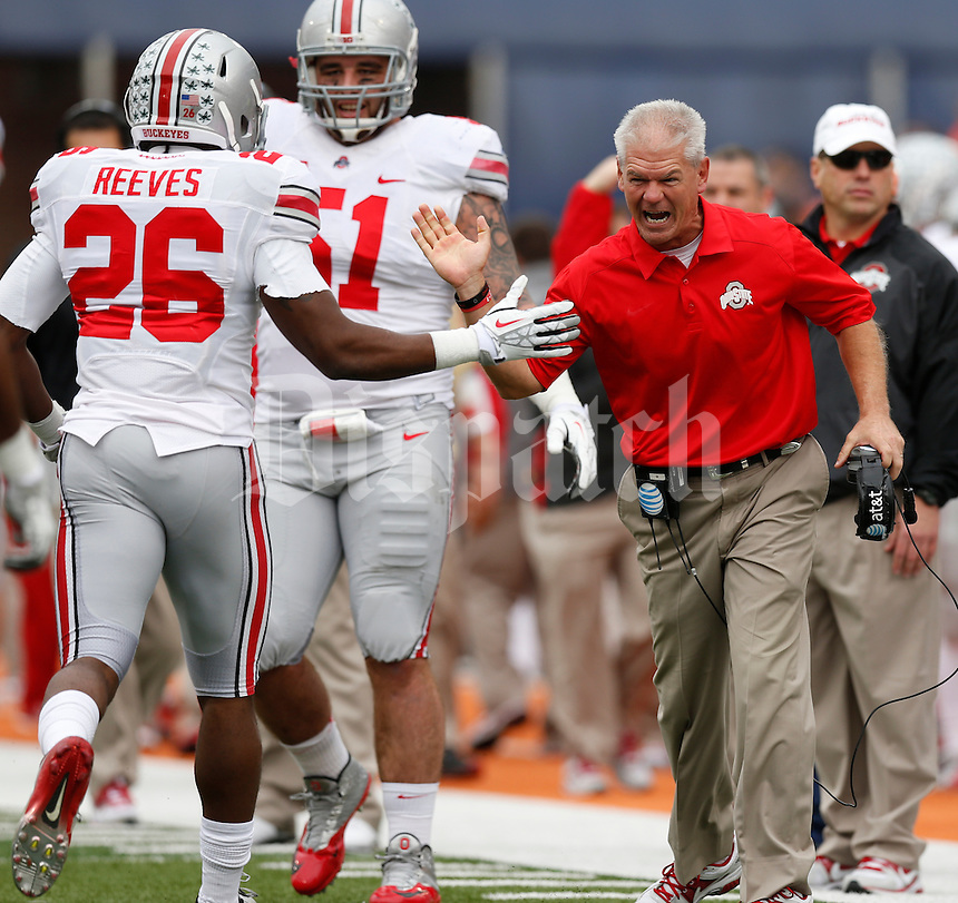 Ohio State assistant coach Kerry Coombs congratulates Ohio State Buckeyes cornerback Armani Reeves (26) on a play during the first half of Saturday's NCAA Division I football game at Memorial Stadium in Champaign, Il., on November 16, 2013. Ohio State won the game 60-35. (Barbara J. Perenic/The Columbus Dispatch)