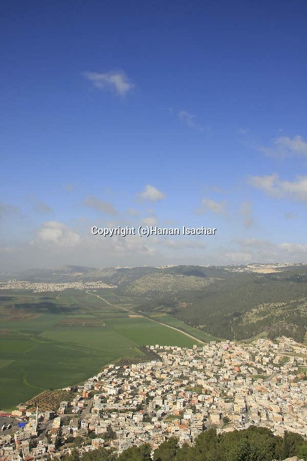 Israel, Jezreel valley. A view of Nazareth mountains and Jezreel Valley from Mount Tabor, Arab village Daburiya at its foothill